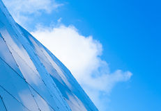 Steel wall panels and blue cloudy sky Royalty Free Stock Photography
