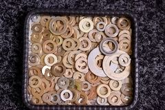 Steel washers on a plate. Various types of washers Stock Photos