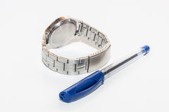 Steel watch and plastic ball pen Royalty Free Stock Photo