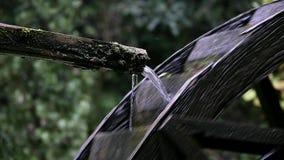 Steel water wheel turning under power.  stock video