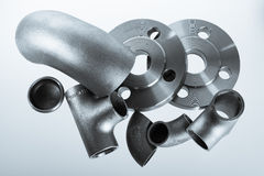 Steel welding fittings and connectors. Elbow, flanges and tee. Royalty Free Stock Photography