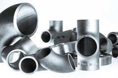 Steel welding fittings and connectors. Elbow, flanges and tee. Stock Image