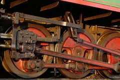 Steel wheels and con rods of smaller Czechoslovak steam locomotive. Royalty Free Stock Photography