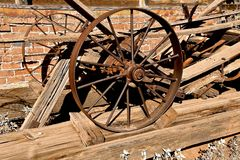 Steel wheels of an old wagon. Remains of an old wooden wagon falling apart with steel wheels and axle Stock Photography