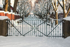 Steel wicket to the winter garden. Stavanger, Norway. Unusual vestcoat winter. Iron gates stock photo