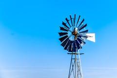 Steel Windpump in the semi desert Karoo region in South Africa. Close up of a Steel Windpump in the semi desert Karoo region in South Africa Stock Photo