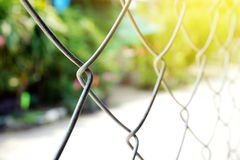 Steel wire fence over sunny light , motivation or freedom concept Royalty Free Stock Photos