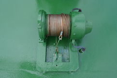 Steel wire on a green cable drum aboard a ship Royalty Free Stock Photo