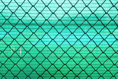 Steel Wire mesh on green slan background Royalty Free Stock Photo