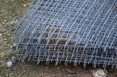 Steel wire net on the ground Royalty Free Stock Photos