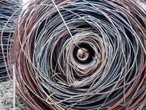 Wire reeled up on a pipe Royalty Free Stock Images