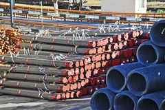 Steel wire roll and pipe Royalty Free Stock Images