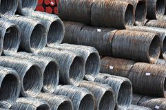 Steel wire roll and pipe Stock Photo