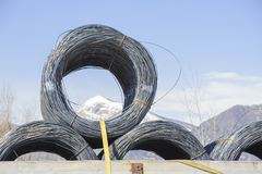Steel Wire Rolls. Steel wire rolls industrial construction products on transport trailer Stock Photo