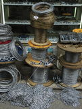 Steel wire rolls. Piles of steel wire in front of the hardware store Stock Photos