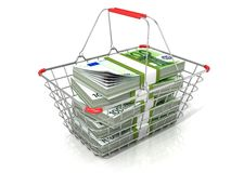 Steel wire shopping basket full of euros stacks Royalty Free Stock Photo