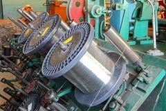 Steel wire spools of Braiding machine.Flexible metal hose produc Stock Photography