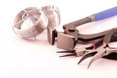 A steel wire and tools on white Royalty Free Stock Photo