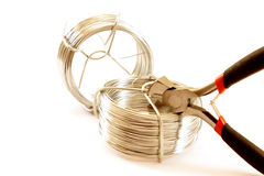 A steel wire and tools on white Stock Images