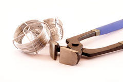 A steel wire and tools on white Royalty Free Stock Image