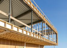 Steel and wood construction of a commercial building, construction site. Metal and wood construction of a modern commercial building, room for text royalty free stock images