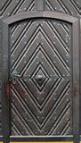 Steel and Wood Door. View of a unique, fortress-looking wood and steel door royalty free stock photos