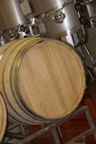 Steel and woodenl barrels in winery Royalty Free Stock Photography