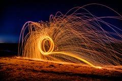 Steel Wool Circles on beach. Steel Wool Flames on Gandy Beach Florida with long exposure stock image