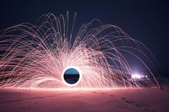 Steel wool photo, a Mysterious portal of sparks in the winter night,. A black hole, strange things happen this night Stock Photos