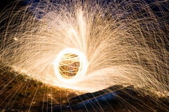 Steel wool sparks. Spinning lit steel wool sparks at night Stock Photo