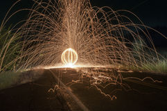 Steel Wool Sparks in the Street. Spinning lit steel wool sparks flying around on the street stock photography