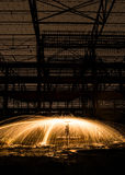 Steel wool sparks in warehouse Royalty Free Stock Photos