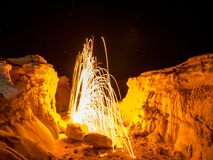 Steel Wool Spinning - Colorado Rocks. Sparks flying from spinning steel wool in a rock formation in Colorado Royalty Free Stock Images