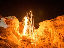 Steel Wool Spinning - Colorado Rocks. Sparks flying from spinning steel wool in a rock formation in Colorado Royalty Free Stock Photos