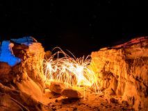 Steel Wool Spinning - Colorado Rocks. Sparks flying from spinning steel wool in a rock formation in Colorado Stock Photography