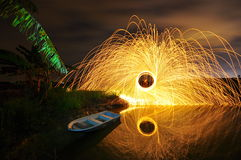 Steel wool stock photo awesome reclection. Taken near paddy field with small stream and small boat Royalty Free Stock Photo