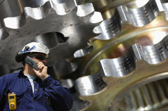 Steel worker and gears Royalty Free Stock Images