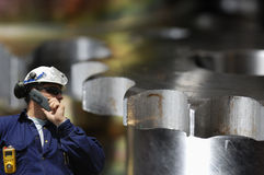 Steel worker and gears Royalty Free Stock Photos