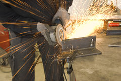 Steel worker grinder Stock Image