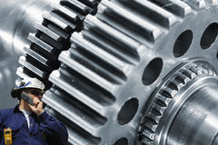 Steel worker with large cogwheels machinery Royalty Free Stock Photo