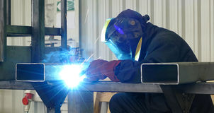 Steel worker welding Stock Photo
