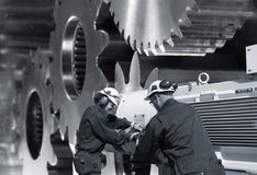 Steel workers and gears Royalty Free Stock Photo