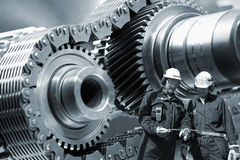 Steel-workers and machinery Royalty Free Stock Photography