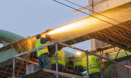 Steel workers. Prepare for the transfer of the steel bridge Royalty Free Stock Photo