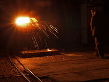 Steel Works steel production. Molten, glowing, yellow, white, metal plavitsya.ognennye sparks fly. worker in helmet Stock Photos