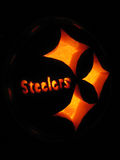 Steelers pumpkin. In the dark royalty free stock photography
