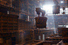 Steelmaking ladles on crane hanging on steel mill royalty free stock photography