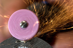 Steels grinding using abrasive tool Royalty Free Stock Photo