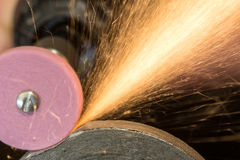 Steels grinding using abrasive tool Royalty Free Stock Images