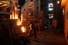 Steelworker near a arc furnace Royalty Free Stock Image